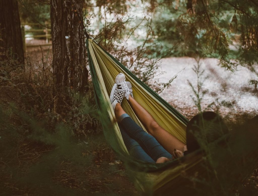 Girl in the Forest sleeping in a Hammock