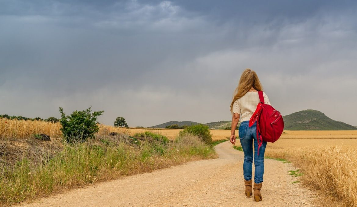 women travel with sling backpack