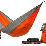 Orange camping hammock with tree straps