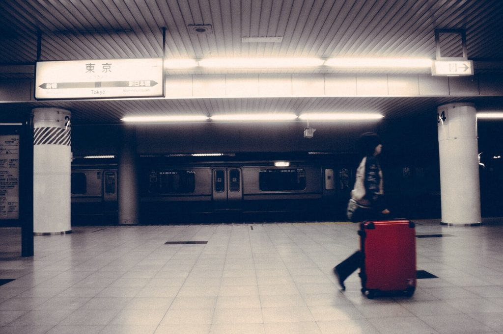 train station and guy with baggage