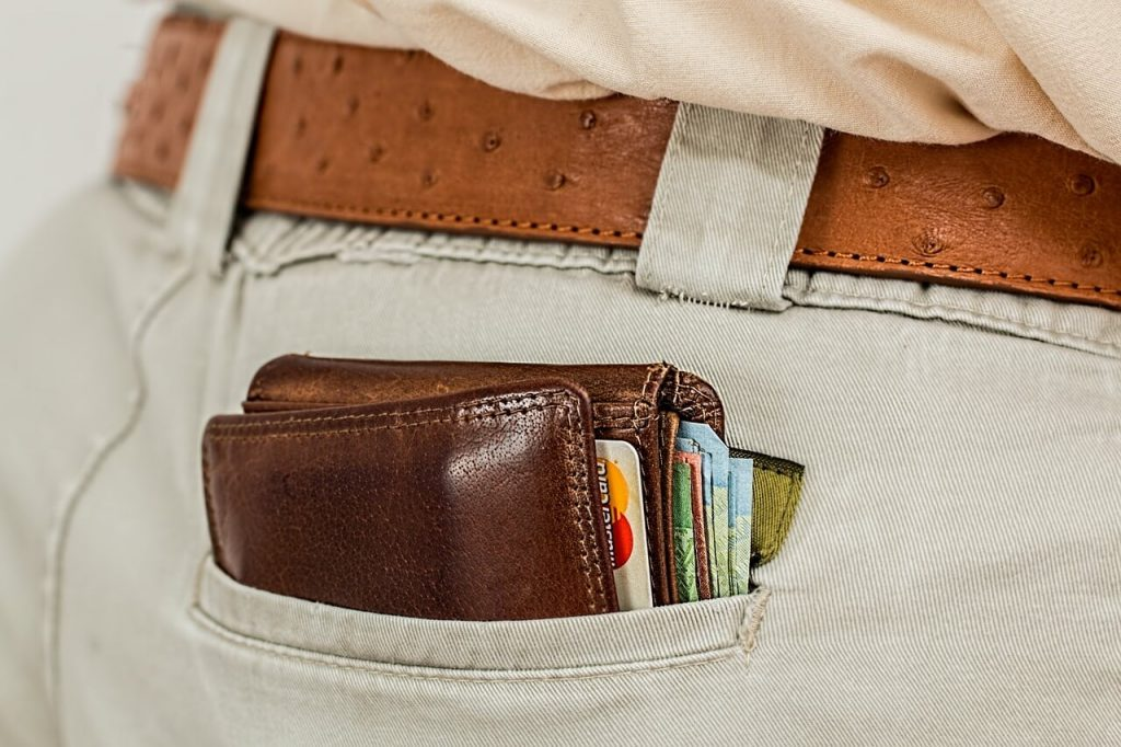 wallet full with money in pocket