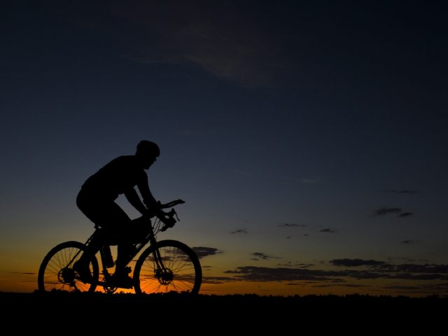 bicyle on rad in dark