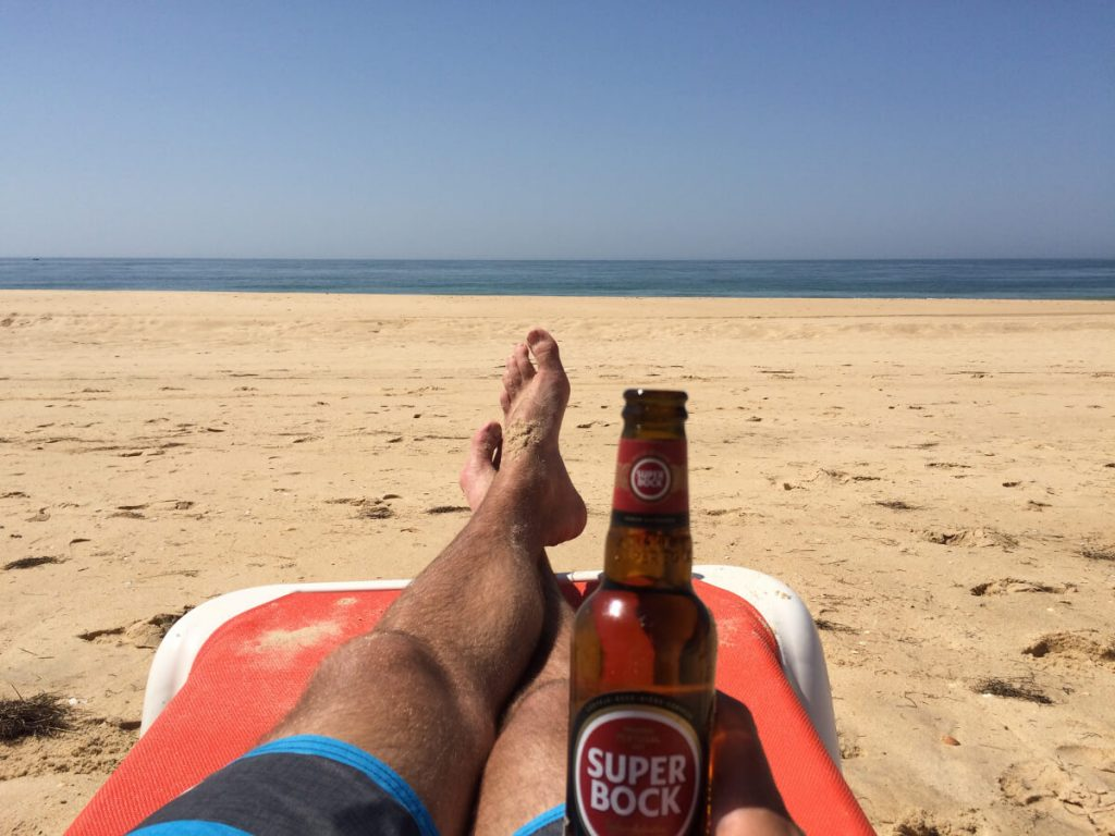 Portugal beach with beer in hand