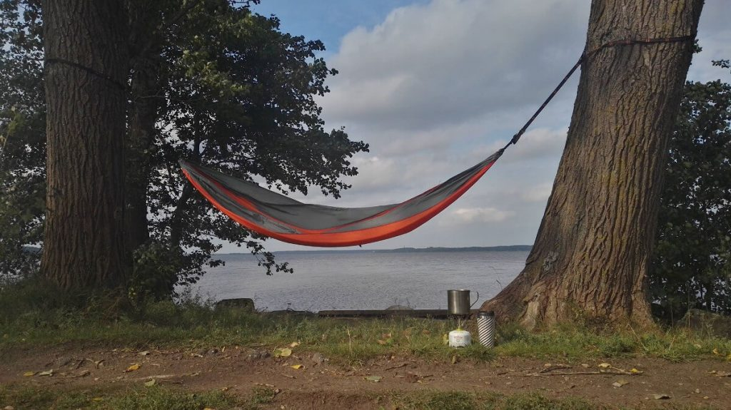 camping hammock and lake