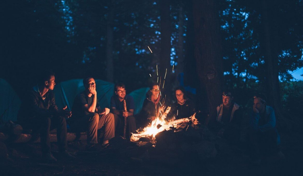 Group of people by bonfire