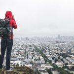 backpacker with backpack for camera take photos