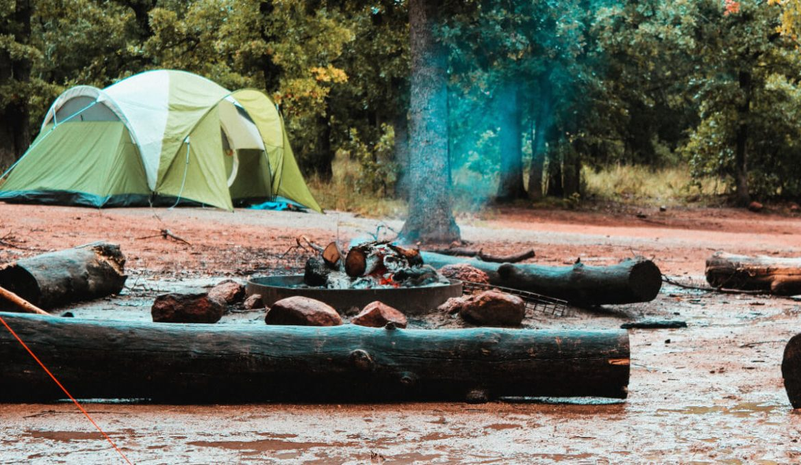 bonfire surrounded and large camping tent during daytime