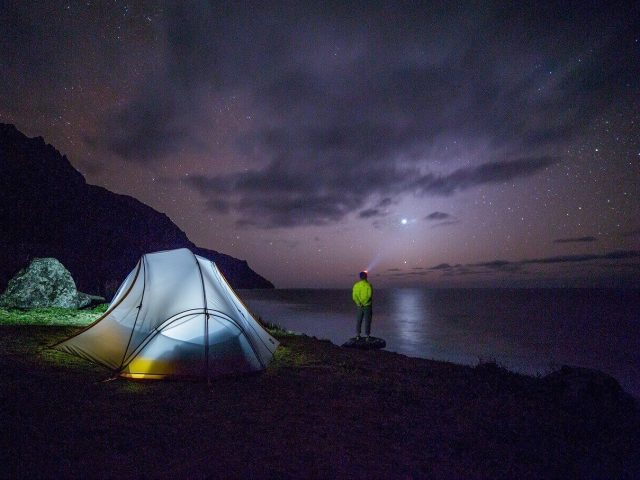 camping in the night with headlamp