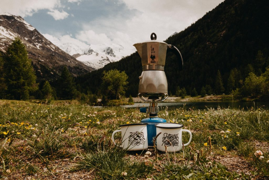 camping stove and coffee mugs