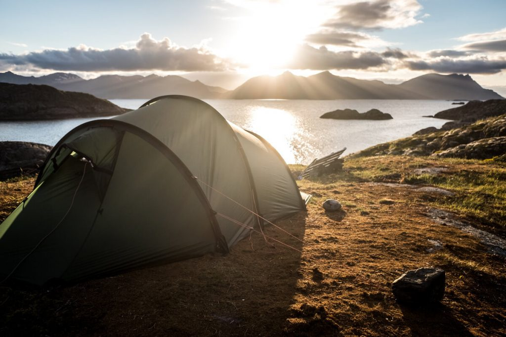 gray 6 person tent on top of mountain
