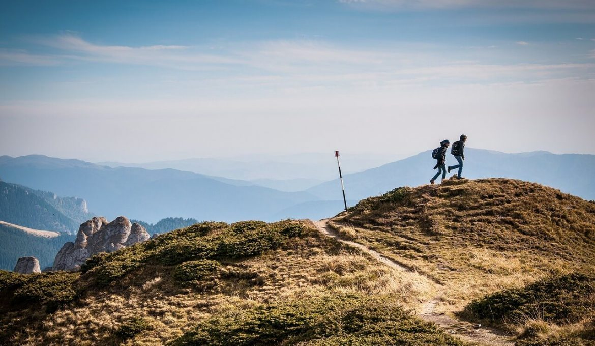 hiking with backpacks in mountains