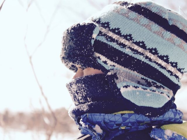 person with a scarf and hat
