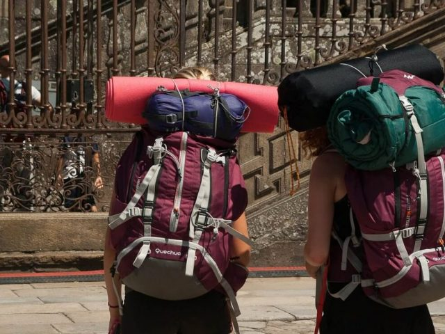 two backpackers with internal frame backpacks