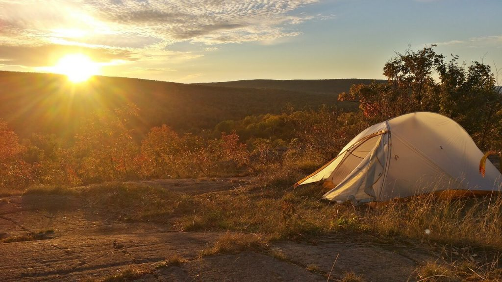 white backpacking tent in sunset