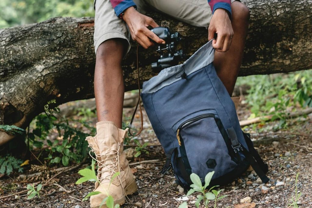 guy with weekend travel blue hiking backpack