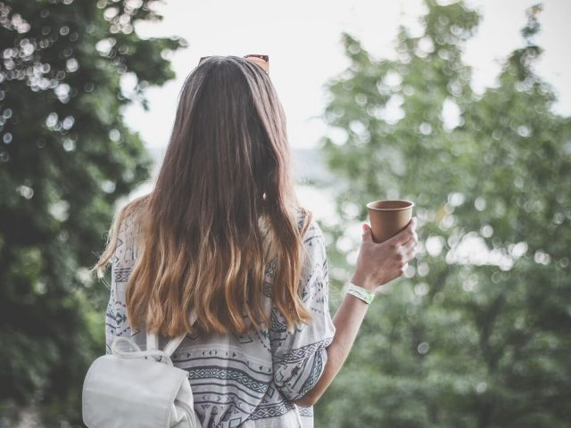 travel girl with cup of coffee