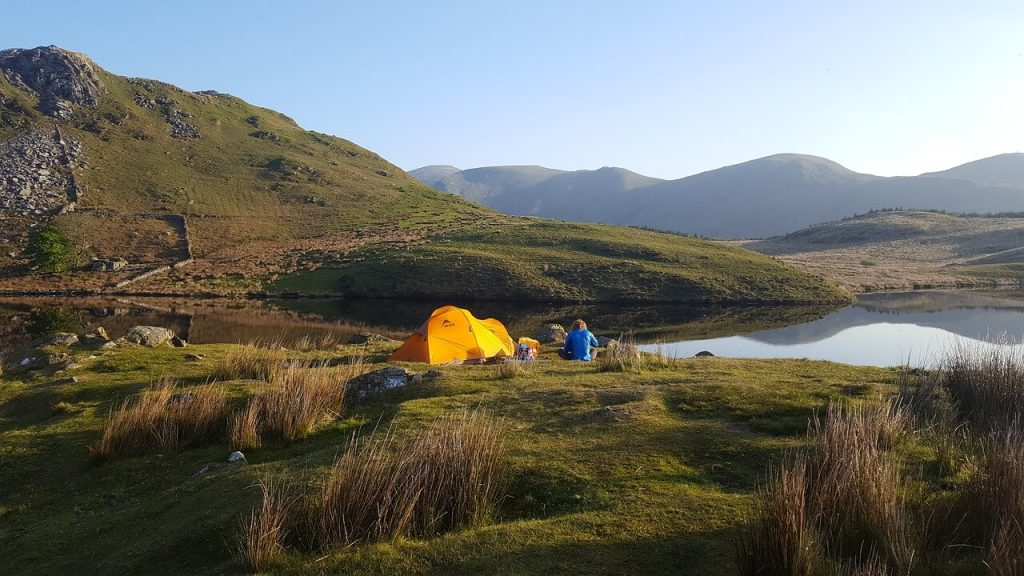 camping tent and campsite near water