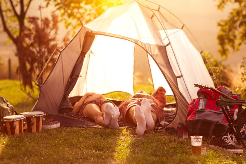 couple sleeping in tent - hot summer morning