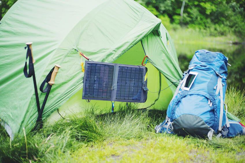 solar panel hangs on the camping tent