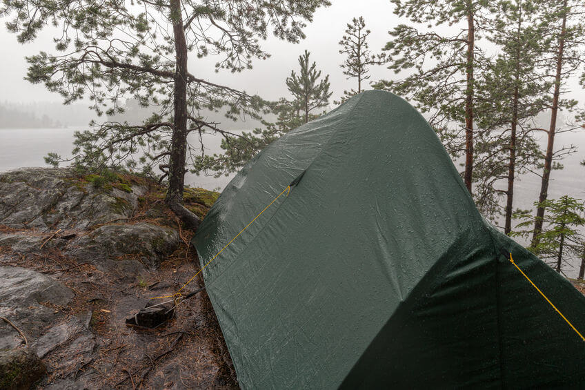 wet tent in the rain in the woods