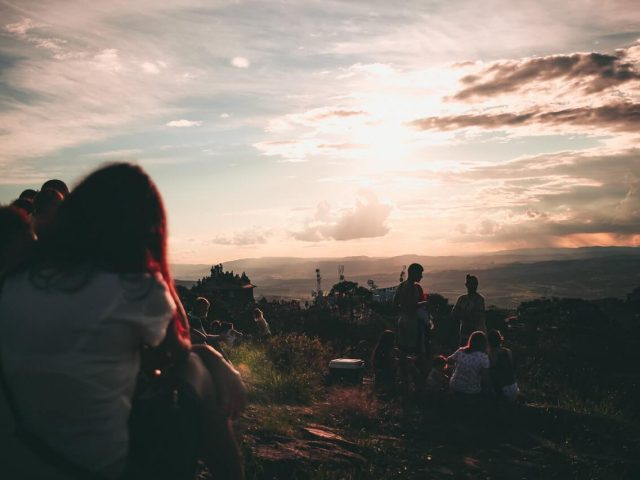 silhouette photography of people in picnic sunset