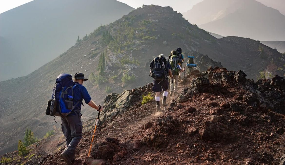 group of backpackers walking in mountain