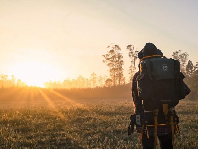 hiker with external backpack during Golden Hour