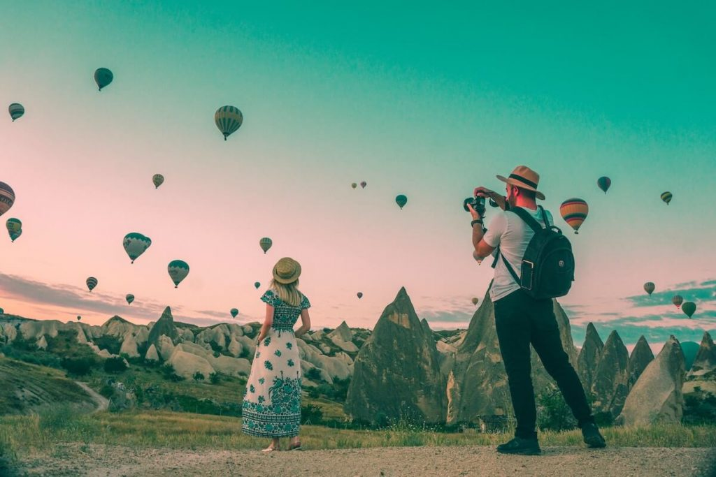 two people looking at hot air baloons