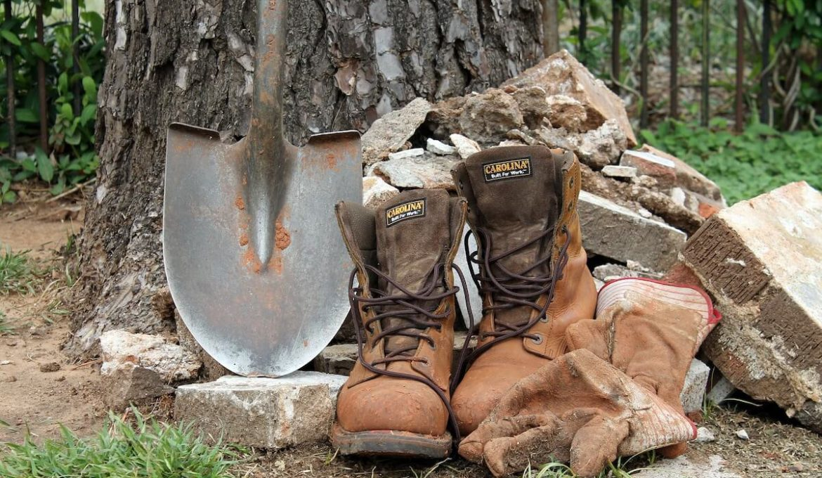 shovel and brown hiking boots