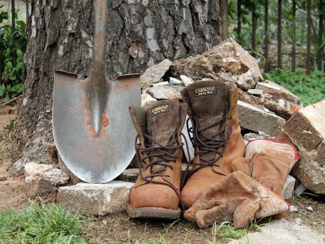 shovel and work boots
