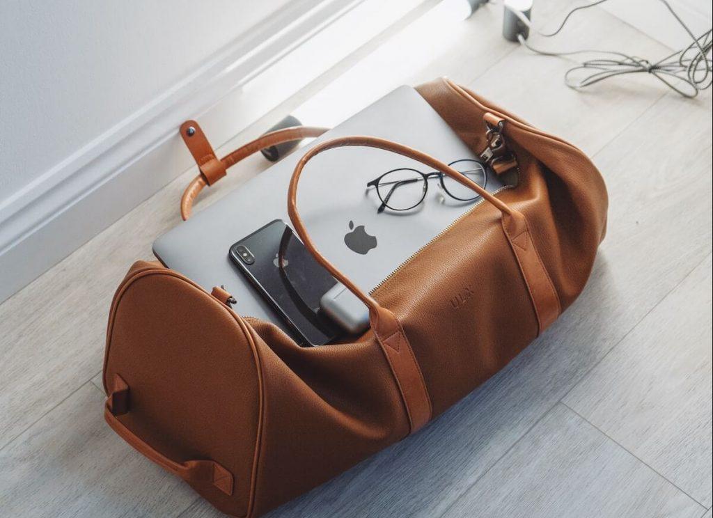 brown luggage bag on floor