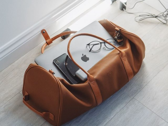 brown luggage bag on floor
