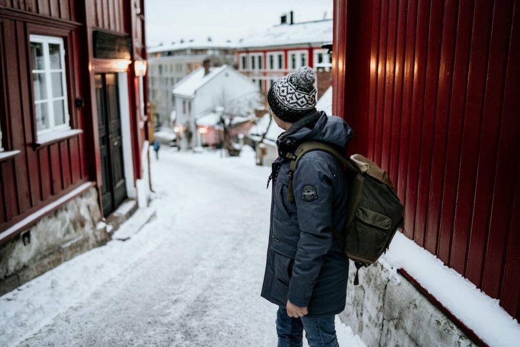 man in city in winter