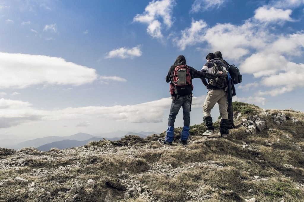 people with gaiters hiking
