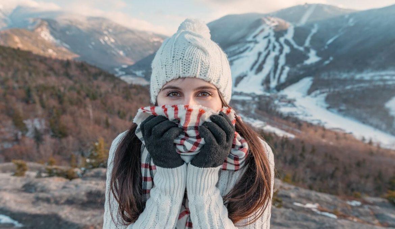 women hiking in mountains in winter