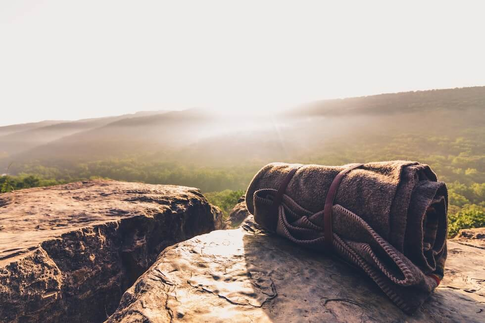 a travel blanket placed on rocks