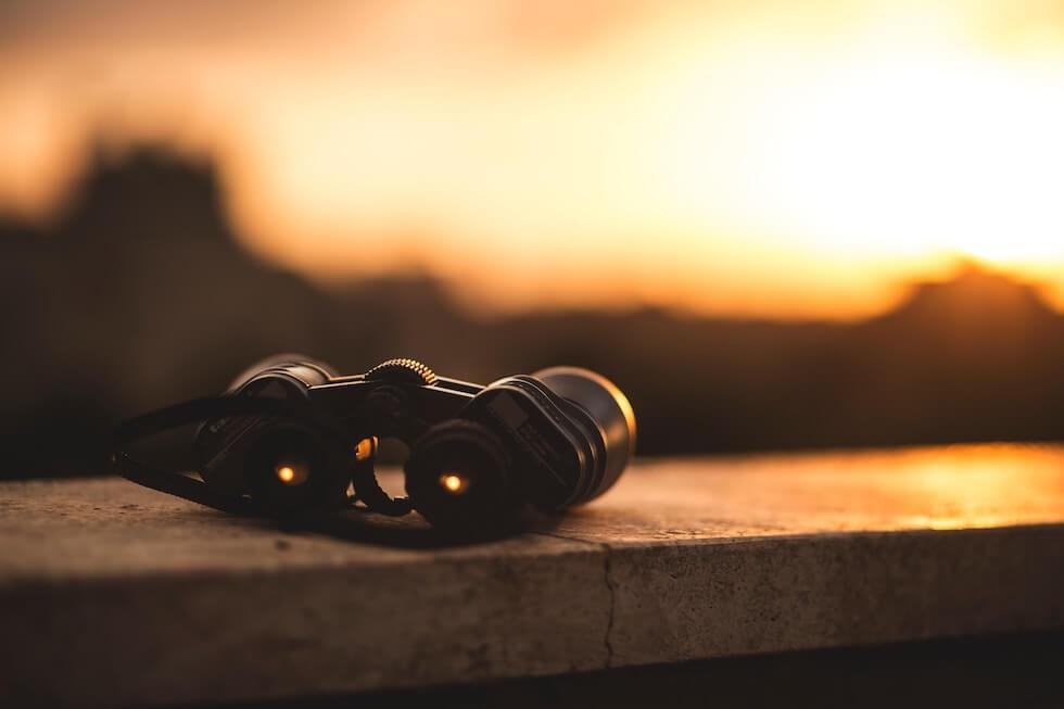 binoculars in sunset