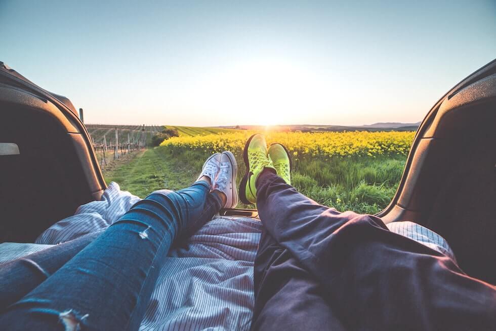 legs of people sleeping in a car
