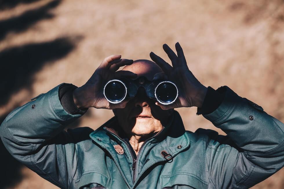 old man with binoculars