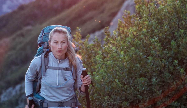 women hiking with trekking poles