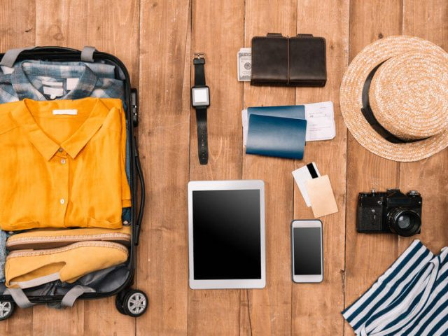 flat lay of solo trip travel items
