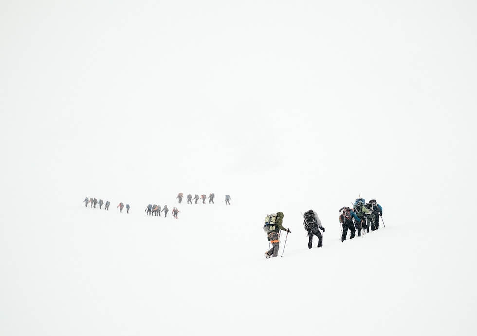 group of people hiking in mountains