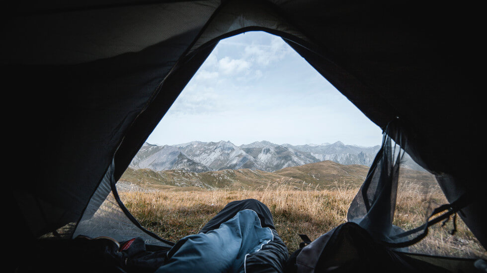 view to mountains from camping tent