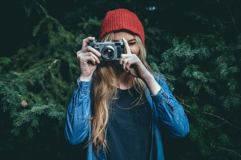 girl using a compact camera