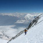 person treks on mountain