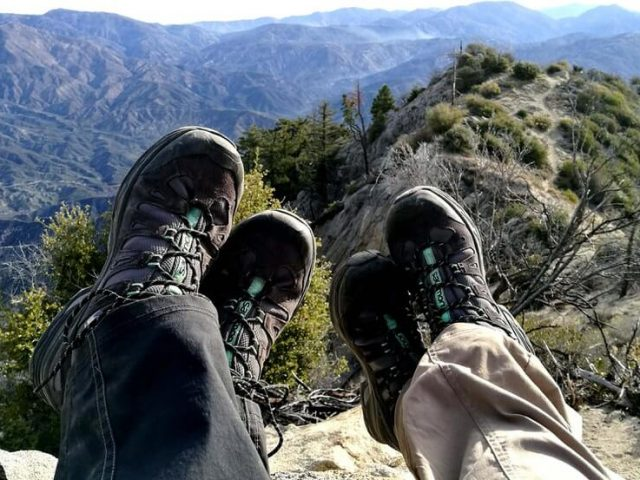 two person wearing hiking boots