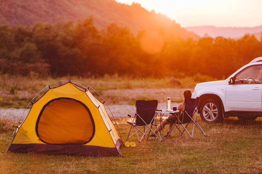 yellow tent near to car - car camping concept