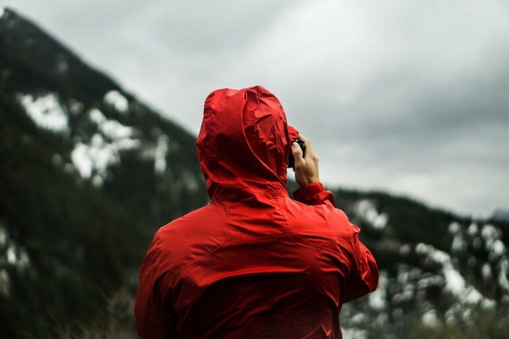 hiker wearing lightweight rain jacket