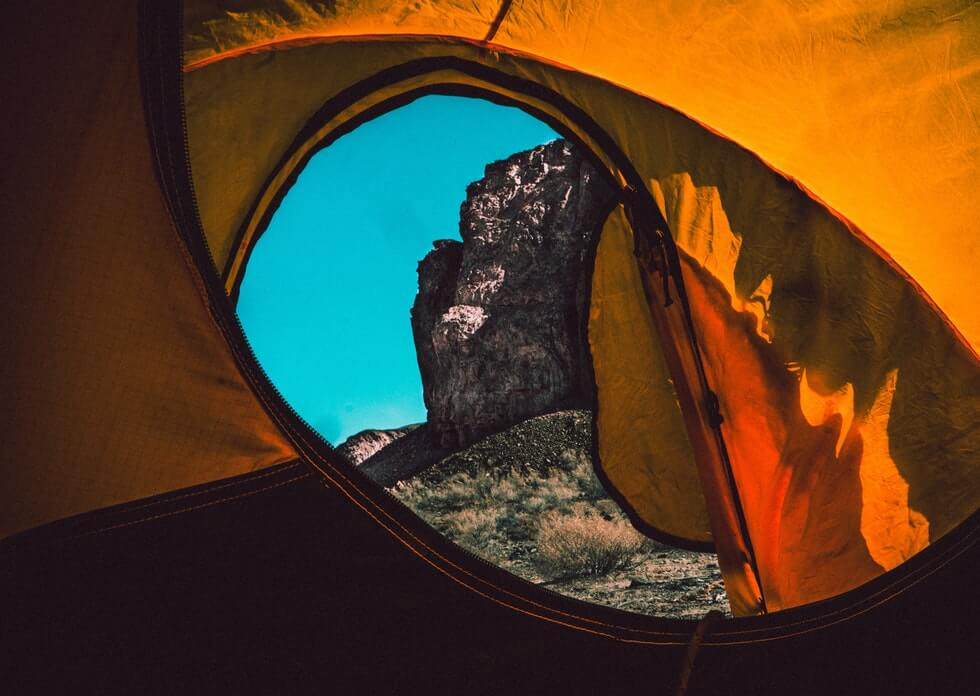 view from backpacking tent to mountains